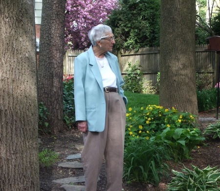 My mom, taking stock of the garden, April 2006. Notice the pen behind her ear.