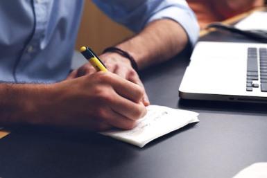Man taking notes on paper